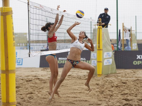 Marie-Christine Lapointe (L) of Canada and Merve Nezir of Turkey in action at the FIVB  Beach Volleyball World Tour Xiamen Open 2017 on April 20, 2017 in Xiamen, China.