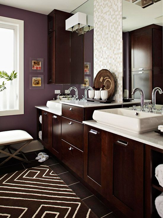 Dark and Light- As this opulent bath shows, you can go with dark cabinets and deep color without getting gloomy. The pairing of dusky amethyst walls and coffee-color cabinets works beautifully because of white, iridescent, and clear glass tiles paired with expansive mirrors, white plumbing fixtures, and glittering marble countertops  Pinned from PinTo for iPad 