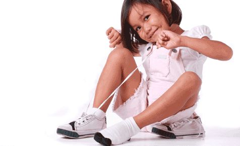 Learning to tie your own shoe laces is a tricky fine motor skill for children, but with patience and practice parents can teach their child to tie their own laces. #backtoschool