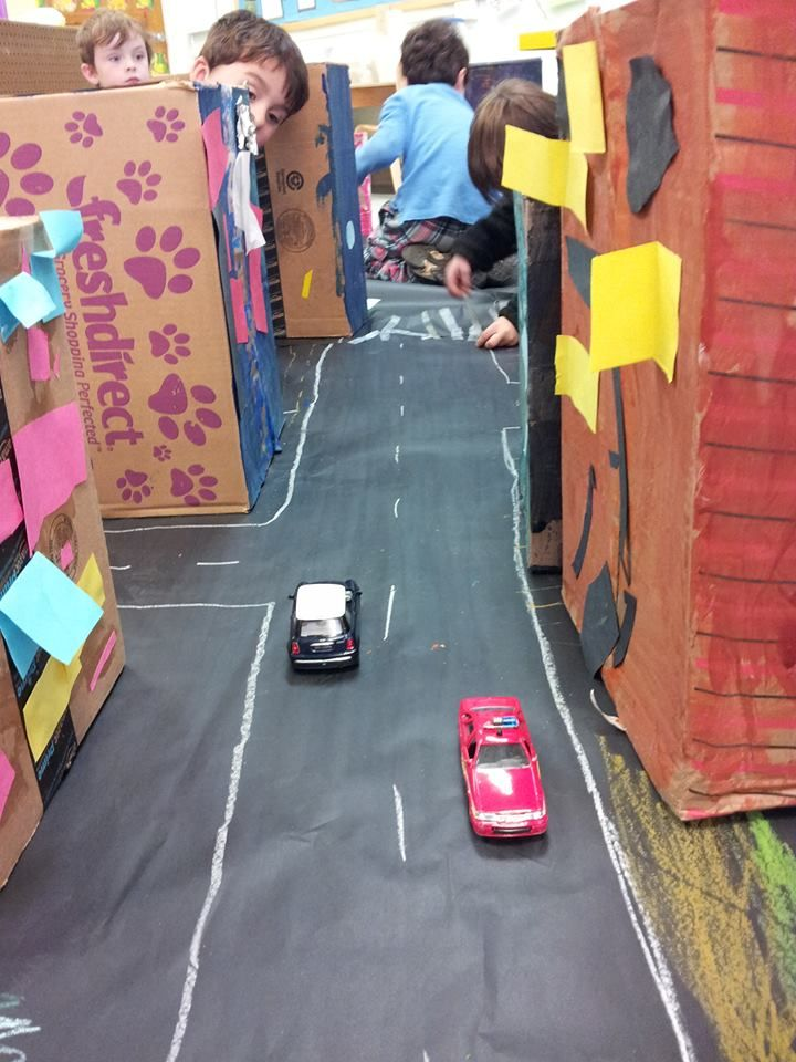Build a city out of boxes - could adapt for people who help us topic, town with police, hospital and fire station etc, cars and small world people for play.