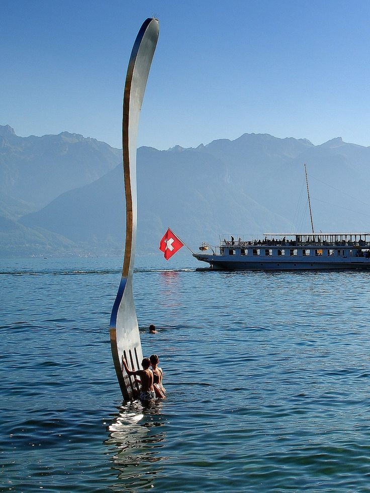 Giant fork (over 500 kg - 1100 pounds ) planted in Lake Geneva in front of Alimentarium Food Museum (part of the Nestle Foundation), Vevey, Switzerland