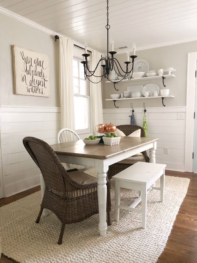 Farmhouse with half wall shiplap. Loren's dining room features half wall shiplap and neutral decor. Table, white chair and bench: Thrift stores. More on Home Bunch blog