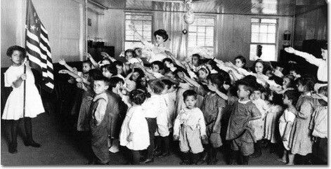 The nazi salute was originally in america it was called the bellamy salute. The hand over the heart as a salute was implemented later in the 1940s by americans