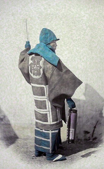 "I love the fire fighter and fishermen coats from this era...""Hikeshi"" (Japanese fire fighter). ""Fire Master"",Photography by  Felice Beato, 1866–67. Hand-colored albumen silver print in Views of Japan (1868). 10 7/16 x 8 in."