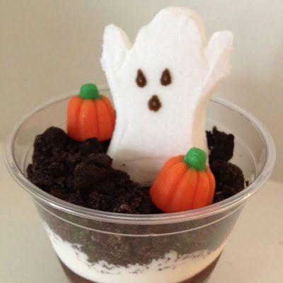 "Halloween Treat: Graveyard ""dirt"" dessert - chocolate pudding, cool whip, crushed oreos, ghost peeps & candy corn pumpkins! Yum!"
