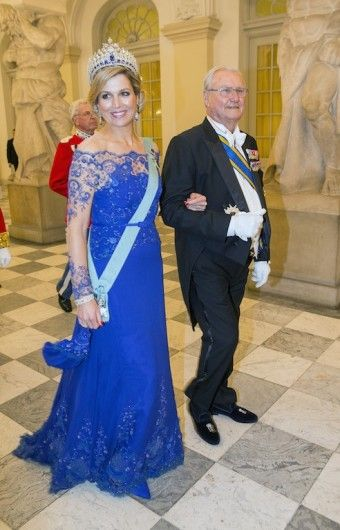 The queen in the blue Jan Taminiau dress that she also wore to the coronation. Click on the image to see more looks.