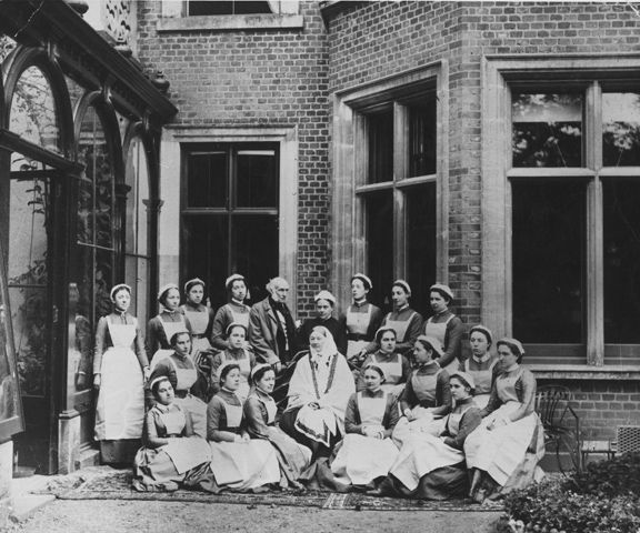A photograph of Florence Nightingale with some nurses in London.