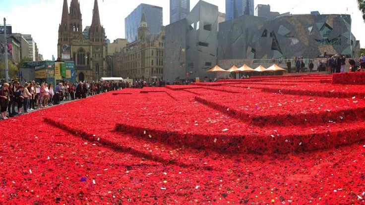Hand-made poppies placed around Federation SquareMelbourne's Federation Square has been blanketed in hand-knitted poppies, woven individually and donated from around the world to honour fallen soldiers for the Anzac centenary.  The project was the brainchild of Melbourne woman Lynn Berry, who first put out the call two years ago requesting 120 poppies to honour her father, who served in World War II.  After quickly reaching her goal, she took the project online and set a new challenge in a…