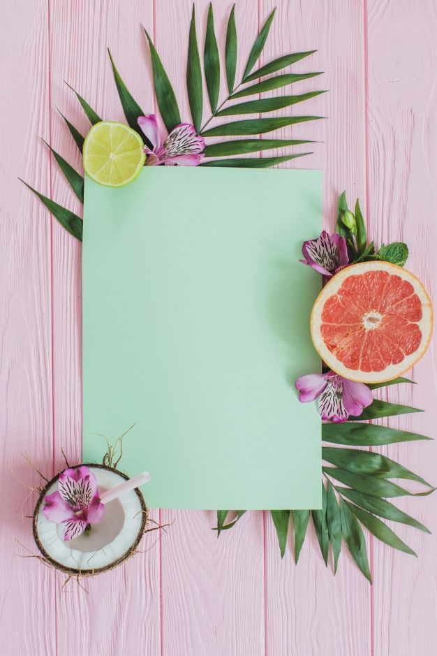 Pink wooden surface with paper for messages and decorative fruits Free Photo