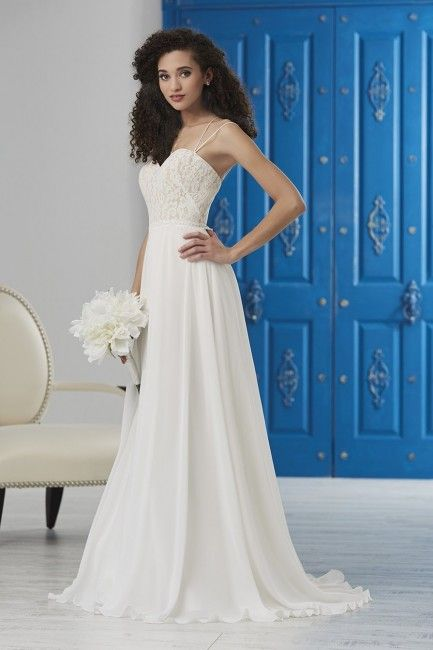 cd19ddd8f32 ... straps lead from the lace bodice with a sweetheart neckline into the  semi-open back of this Christina Wu Destination 22859 ivory wedding dress.