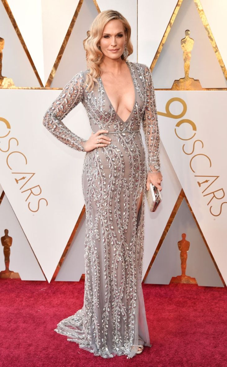2018 Oscars: Molly Simms is wearing a silver embellished Naeem Khan long sleeve dress with a plunging neckline. This dress is gorgeous and fits Molly like a glove! Hair is amazing too!