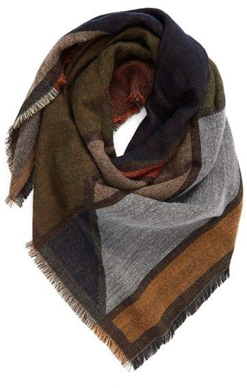 Bundle up in a warm, patterned blanket scarf.