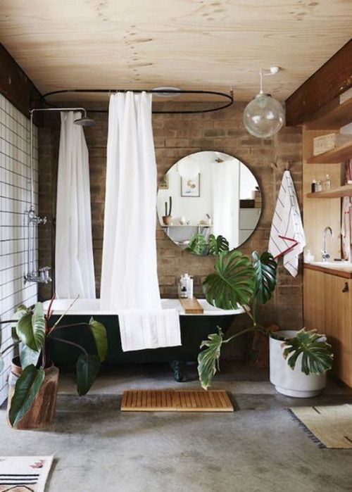 Now this is a spa bathroom! A luxurious tub and accessories with a 70s vibe complete this space.
