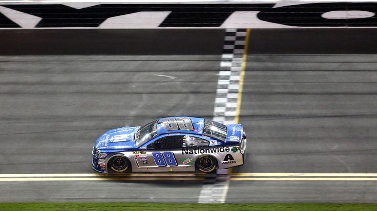 DAYTONA 500 QUALIFYING:   Dale Earnhardt, Jr. crosses the finish line to win the first of the twin qualifying races for the Daytona 500, at Daytona International Speedway, in Daytona Beach, Fla., Thursday night, February 18, 2016. (Joe Burbank/Orlando Sentinel)