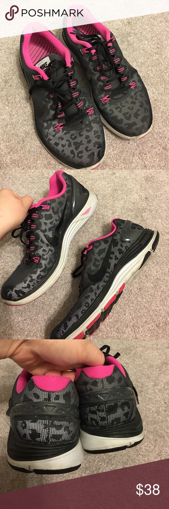 Cheetah print Nike Lunarglide 5 tennis shoes. Women's cheetah print lunarglide tennis shoes. Womens size 9.5, some wear to the soles of the shoe and the sides but they still look really cool. Nike Shoes Athletic Shoes