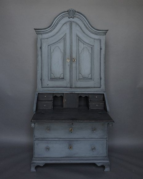 Rare compact secretary, Norway circa 1760, in blue paint.  Graceful arched cornice with central shell-like detail over two shaped doors.