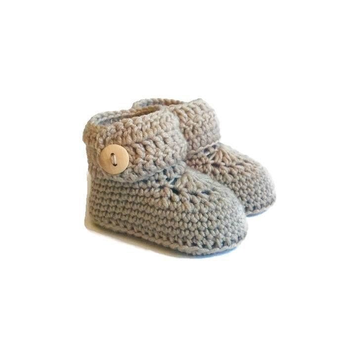 Short knitted button cuff baby booties handmade in beige merino wool by Warm and Woolly