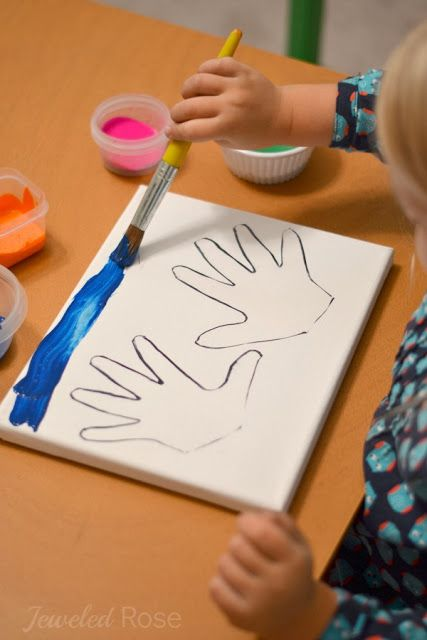 """This handprint """"paint resist"""" art project is a fun art activity for kids and a great keepsake for mom and dad!"""