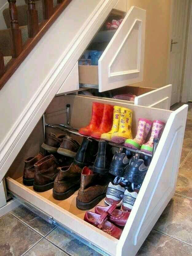 A great way to get some use out of the useless space underneath the stairs!! Extra storage space