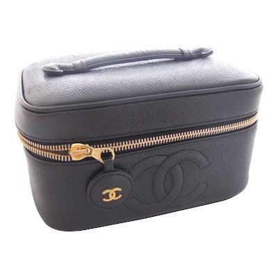 Chanel make up/travel bag.... I want this!!!
