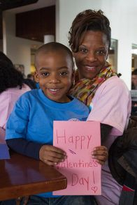 Elijah Wesley, 5, and his mother Octavia Wesley, of Mays Landing, made Valentine's Day cards at Stockton College's 10th Annual Day of Service Jan. 20.   Photo: Susan Allen/ The Richard Stockton College of New Jersey