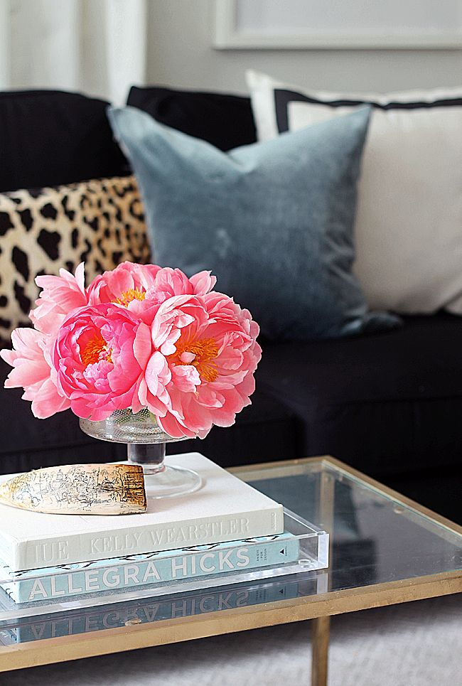 Gold and glass mixed with bright fresh flowers is the perfect way to show off your table Coffee table accessories