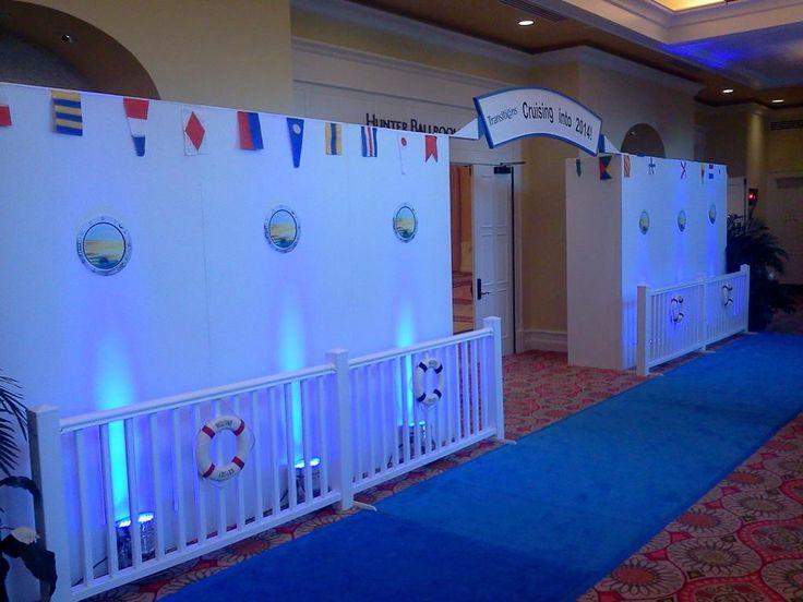Cruise Ship Entrance with custom signage, up-lighting, nautical accents and blue carpet runner #FLeventdecor