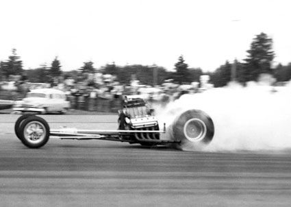 Tommy Ivo Barnstormer - Part 1 - Here at Seattle on July 1, 1962, one of the very first runs on the car, which would ultimately persevere as one of the longest running competitive cars ever fielded in Top Fuel. Arguably it has the most colorful history. It was at the top of it's class running the first ever 7 second run only a few races after it was built. It ran the first 190 mph runs on the West Coast at a number of tracks.