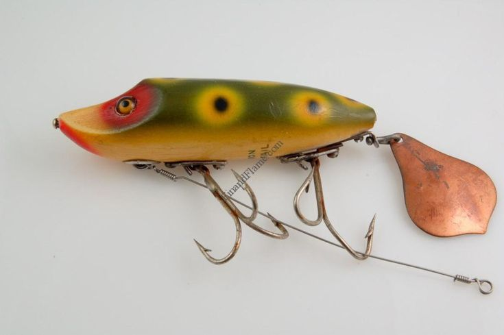Heddon Flap Tail Junior Lure - http://www.finandflame.com/heddon-flap-tail-junior-lure/ - #AntiqueLure, #Fishing, #HeddonFlapTailJuniorLure, #History - Heddon Flap Tail Junior Lure The Heddon Flap Tail Junior Lure was first introduced in around 1935. Heddon of Dowagiac Michigan assigned it a model series number 7110. The Flap Tail was a close cousin to the successful Heddon Vamp lure. The lure had a very similar tapered cigar shape for its...