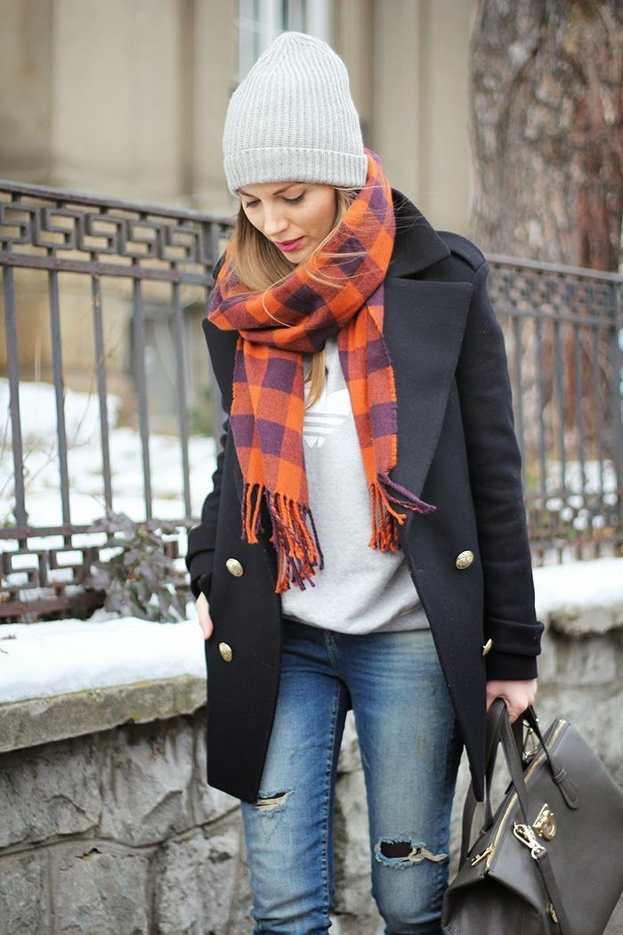 Pair a black coat with blue destroyed slim jeans for a refined yet off-duty ensemble.  Shop this look for $97:  http://lookastic.com/women/looks/beanie-scarf-crew-neck-sweater-coat-tote-bag-skinny-jeans/6241  — Grey Beanie  — Orange Plaid Scarf  — Grey Print Crew-neck Sweater  — Black Coat  — Black Leather Tote Bag  — Blue Ripped Skinny Jeans