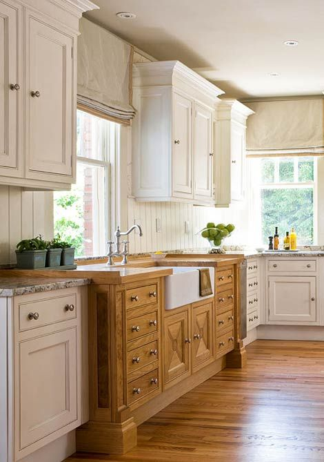 Roman shades, wood contrast cabinets