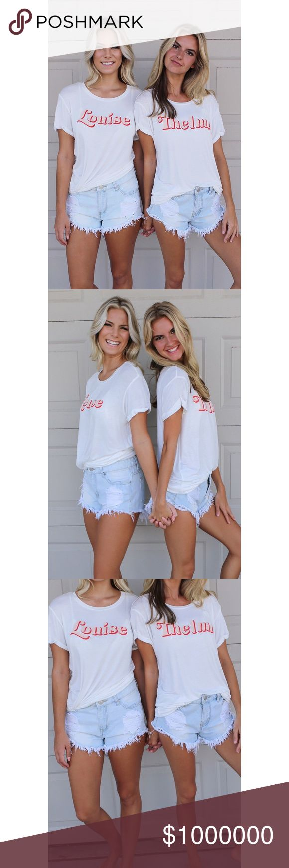 Thelma & Louise BFF Tees Set! Tees Set! One for you and your BFF!!! Red and pink writing with folded sleeve detail! Materials include rayon and spandex.                                                            Bust: 19.                                                                                Length: 27.5 Amazing Lace Tops Tees - Short Sleeve