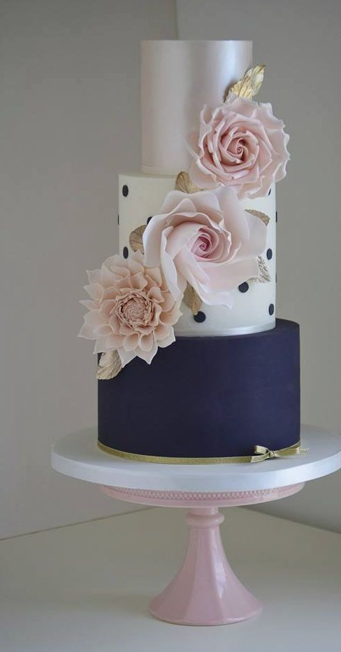 Featured Cake: Cotton & Crumbs; Unique three tier navy, pink and white wedding cake with adorable polka dot detail