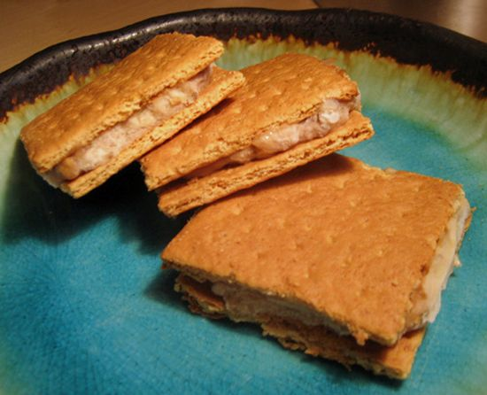 """Bananas and peanut butter mixed together, smashed between two graham crackers, and then frozen. Healthy ice cream sandwiches"
