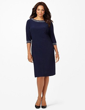 Silky, solid dress. Crystal-like beads adorn the neckline and ends of the three-quarter sleeves for glowing look. Pull-on style. catherines.com