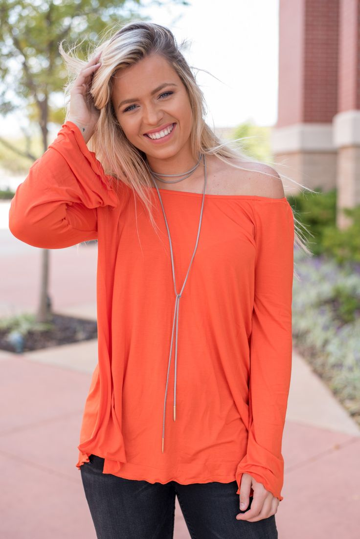Piko long sleeve off shoulder top orange. Off shoulder tops are one of this season's hottest trends and what better way to rock the trend then with the comfort and soft blend of a Piko top! Bell sleev