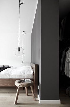 wooden stool / exposed bulb / wooden bed