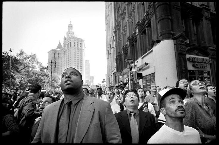 Photograph by Patrick Witty  A crowd of stunned New Yorkers witness the collapse of the South Tower of the World Trade Center on Sept. 11, 2001. TIME's Patrick Witty took this photo twelve years ago. As the nation marks another year passed, he asks for help identifying the people in the picture.