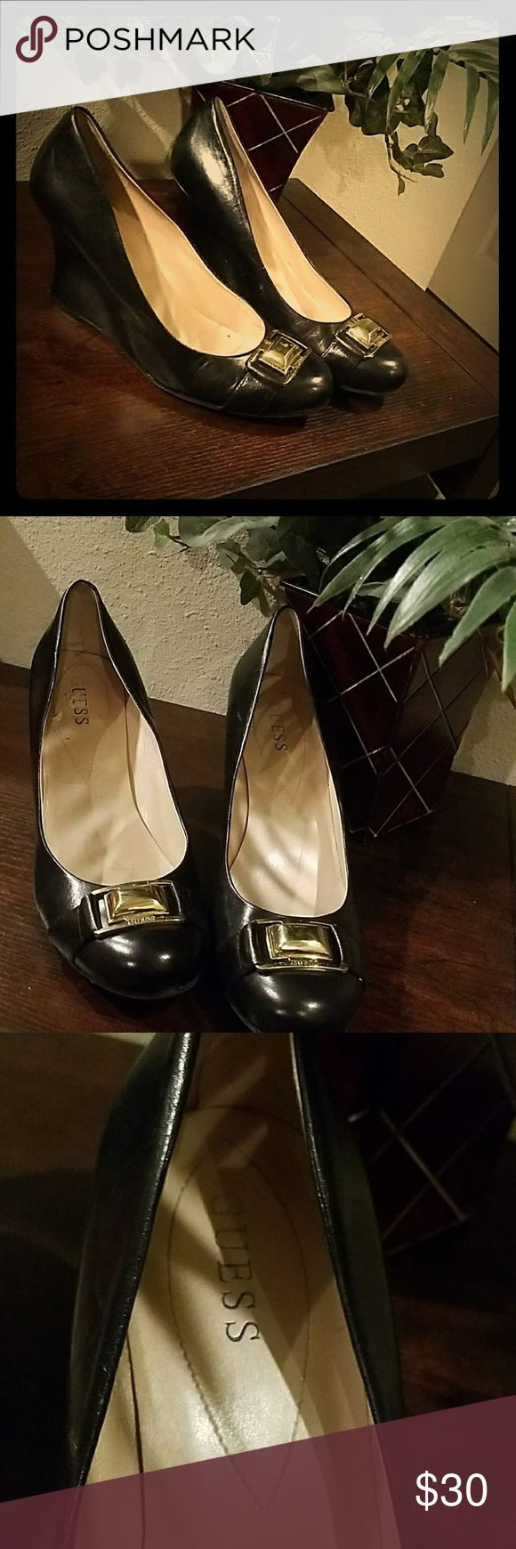 Guess Wedges Black Size 10 Guess Wedges. Size 10. Black with gold emblem on toes. Closed toe. Wedges are 3.5 inches high. Guess Shoes Wedges