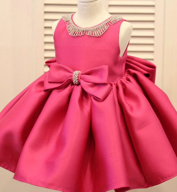 Rhinestone Applique Dress--Made To Order - High Quality Beautiful Rhinestone Neckline Applique Sleeveless Knee Length Big Bow Back Baby Infant Toddler Little & Big Girl Party Dress. Available from 3 months until 12 years old. Material: Polyester fiber, cotton lining, tulle mesh, satin. Color: Pink Bubblegum. Please do compare your  little girl measurements with our size chart.