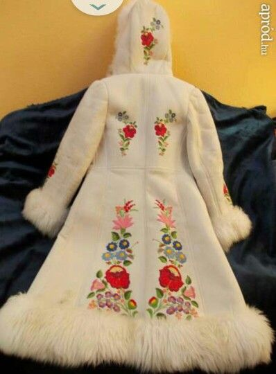 White sheepskin with gorgeous, traditional Hungarian embroidery. Fit for a snow queen.