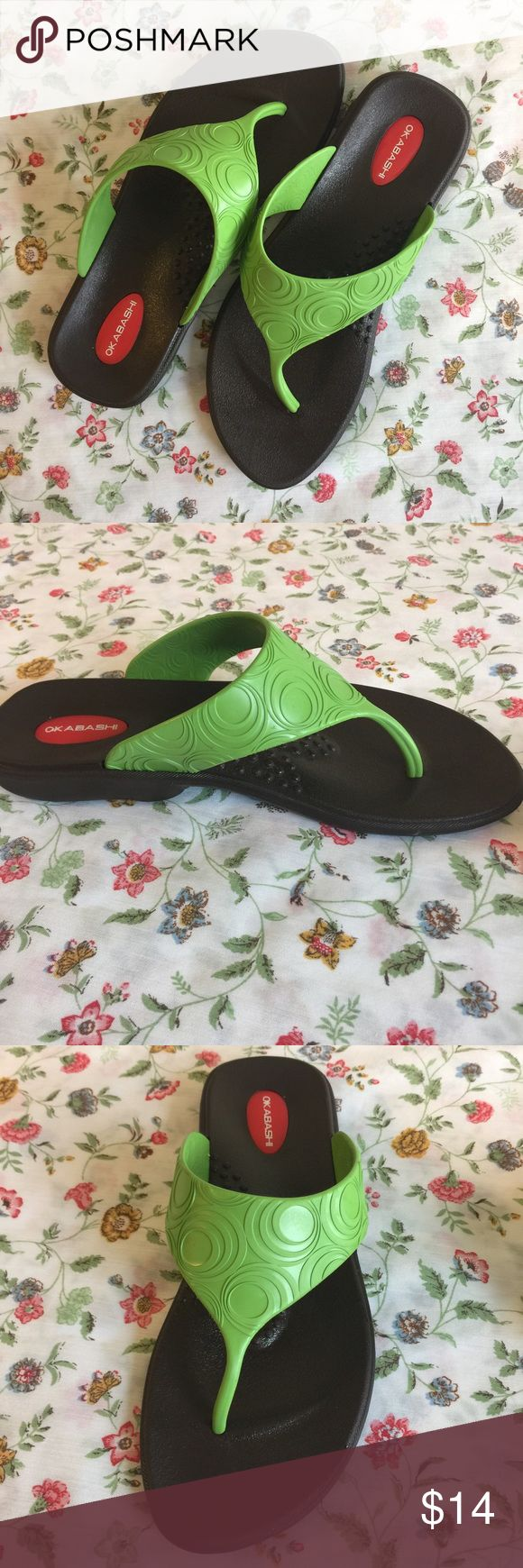 """Okabashi Women's Flip Flops Medium Green 7 8 Water Okabashi women's rubber flip flops, green thong with brown soles. Size medium, which I believe is about a 7-8. Toe to heel, the shoe is 9.75"""". Excellent condition. Very little signs of wear, extremely clean. I personally scrubbed and sanitized these with oxi clean. Very light wear evident to toe beds and soles, overall in great condition! These would be nice water shoes and good for water sports since they have a grippy sole. Made in the…"""