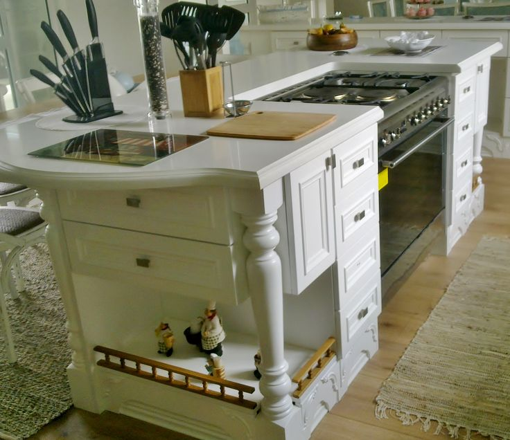 Country Style - Island with Pro Quartz Porcelain Ogee Profiled edges and stunning turned country legs.
