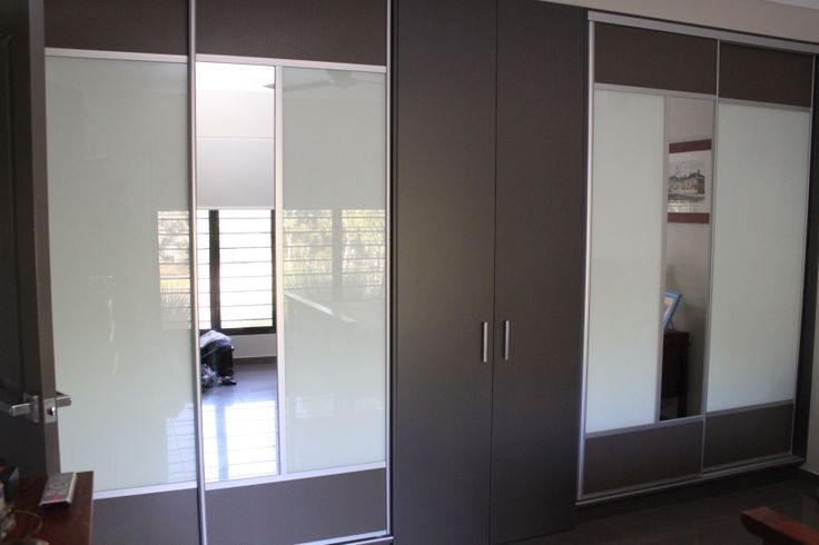 Our clients wanted to keep an existing cupboard and have the sliding doors on either side to compliment.  www.formfunctionnt.com.au