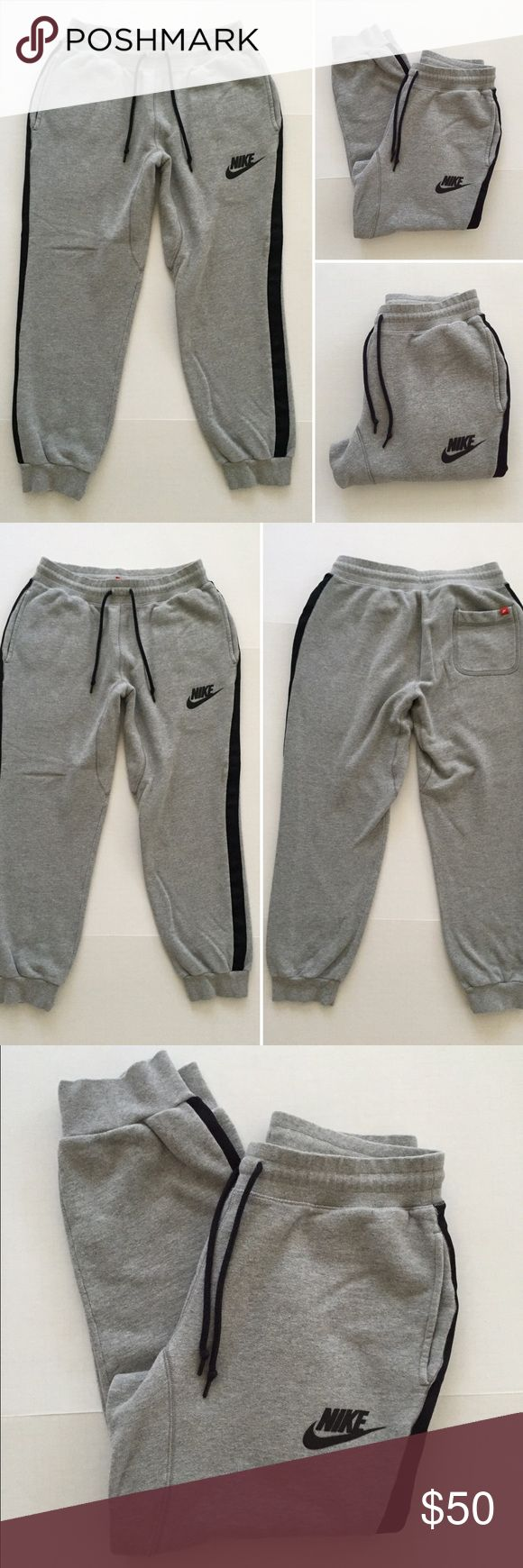 "[Nike] men's athletic gray jogger sweatpants M [Nike] men's athletic gray jogger sweatpants M •🆕listing •good pre-owned condition •grey with black detail 28"" insignia •length/inseam 29"" •2 front pockets, 1 back pocket •material 100% cotton, soft fleece sweats •subtle material changes from wash/wear when looking up very close •Offers welcomed using the offer feature or bundle for the best discount••• Nike Pants Sweatpants & Joggers"