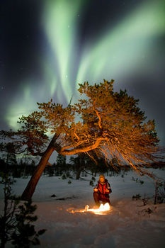 Northern light next to a fire, Abisko, Swedish Lapland | | Lapland's Image Bank, pictures on skiing, fishing, hunting