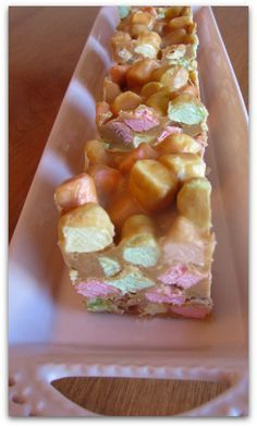Confetti Squares ~ These are definitely not difficult to make. Just a little melting of butter, peanut butter and the chips, then letting the mixture cool a bit. Stir in marshmallows, put them in a pan, toss in fridge and you are done! Older Mommy Still Yummy