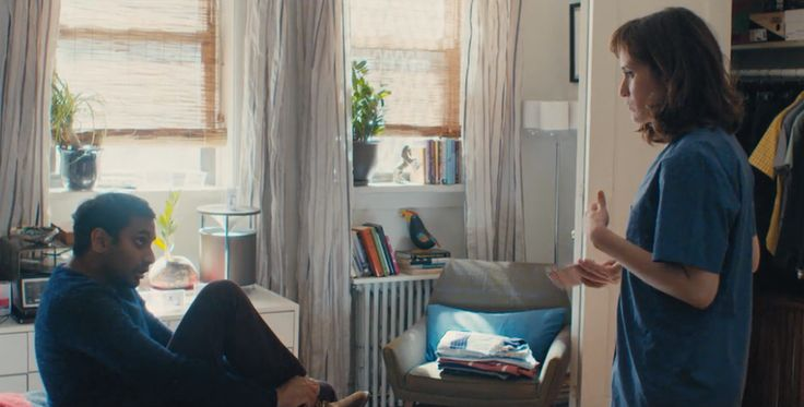 Aziz Ansari's Dev from Master of None and his girlfriend Rachel use a radiator shelf and windowsills as a cheap storage hack and book organizing trick in their NYC apartment.
