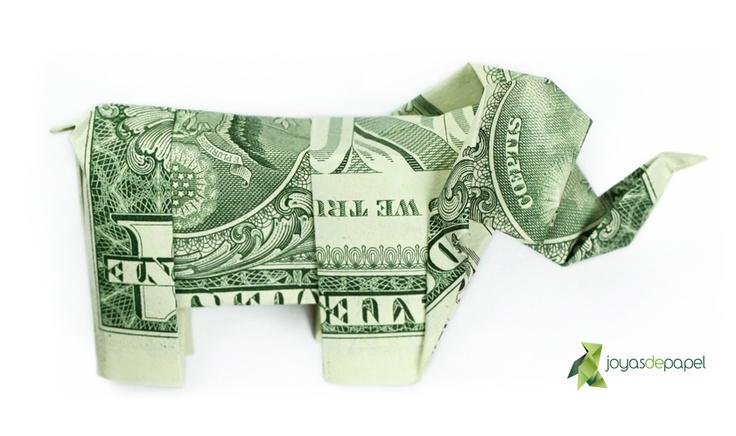Broche con forma de Elefante plegado a partir de un billete auténtico de dólar. ***** Elephant brooch folded from a genuine dollar note. Disponible/Available www.joyasdepapel.com