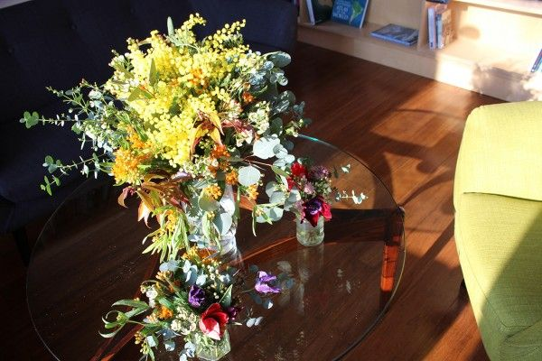 Colourful flowers for a fun event! Pom pom Mimosa, Aneomes, Eucalyptus, Roses and Clematis